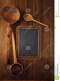 retro kitchen utensils wood spoon on old wooden table in rustic