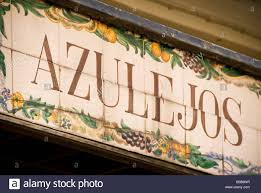 detail of shop sign of painted tiles or azulejos in the