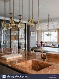 marble worktop kitchen island with bulthaup units and brass
