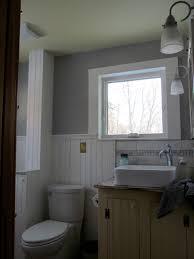 popular white design bathroom idea with bathtub black floor tile