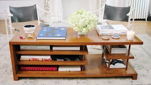 8 ways coffee table books can be used as decor architectural digest