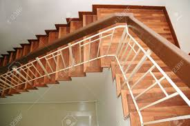 wooden staircase with railings from top view stock photo picture