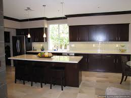 espresso kitchen cabinets with black appliances norma budden