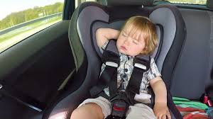 kid car child falls asleep in a child car seat boy baby kid in the
