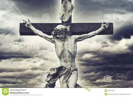 crucifixion christian cross with jesus christ statue over storm