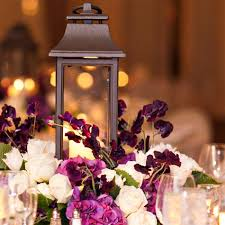Lanterns For Wedding Centerpieces by Images By Berit Iron Lantern And A Pewter Birdcage With Purple