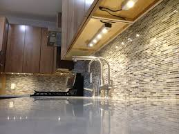 kitchen creative under cabinet lighting with modern backsplash
