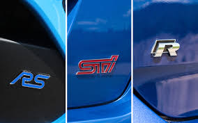 subaru rsti badge comparison test ford focus rs vs subaru wrx sti vs volkswagen