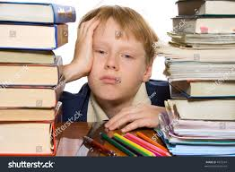unhappy boy sitting by desk full stock photo 4572541 shutterstock