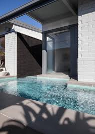 photos hgtv closeup of modern backyard swimming pool with gray