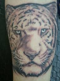 white ink tiger face tattoo on sleeve