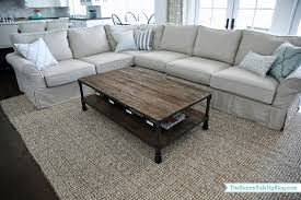coffee table with baskets under baskets with labels the sunny side up blog