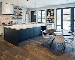 appliances black walnut flooring with round breakfast table also