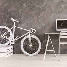 grey room with white bike desk chair computer and diy bookcase Diy Bike Desk