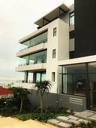frameless glass stacking doors apartment block in sea point cape town sunflex