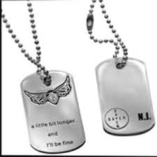 his and hers dog tags miley cyrus wearing nick jonas dog tag rumorshaveit s