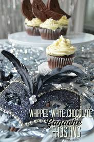 masquerade party cupcakes with white chocolate ganache frosting