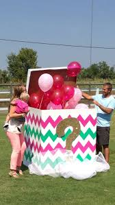 gender reveal balloons in a box gender reveal box photo shoot black and white strips with gold