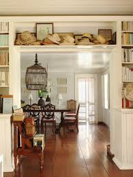 love the wide floorboards u0026 the shelves over the doorway piled