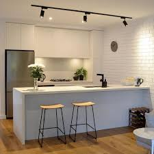 cool track lighting installation above the kitchen island track lighting pinteres