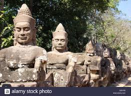 angkor thom statues of hindu devas guardian gods lining road to