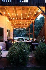 Hanging Patio Lights by How To Decorate A Small Patio Small Spaces Patios And Spaces