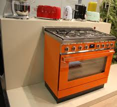 colored kitchen appliances infused with retro charm are making a orange is a very cheerful and vibrant color and it s also easier than you think to