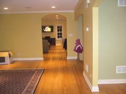gold walls white trim gold toned hardwood floors drapes