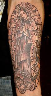 virgin mary n jesus tattoo on arm photo 1 photo pictures and