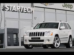 white jeep compass grand cherokee