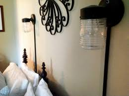 lighting wrought iron wall art and plug in wall sconce with glass