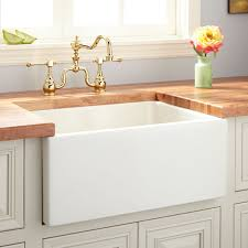 24 fireclay reversible farmhouse sink smooth apron biscuit