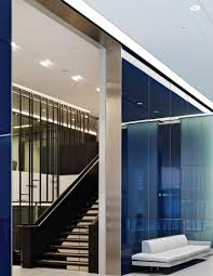 the stunning feature wall and staircase connecting savills double