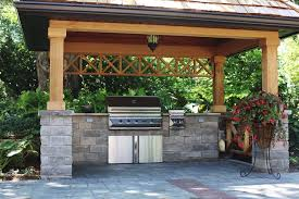 covered bbq area with natural stone counters traditional patio