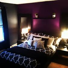 apartment improvement grey bedroom with purple accent wall