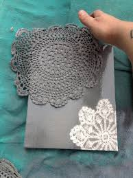 spray paint canvas and doilies this would be neat to do using the