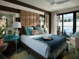residential sliding glass doors interior ceiling fan dark brown ottoman green accent pillows