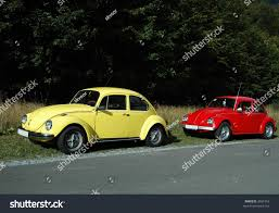 volkswagen yellow car vehicle retro yellow volkswagen beetle 1302 red beetle stock photo 3091953