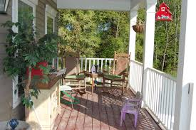 perfect decor of rustic front porches with mini table between