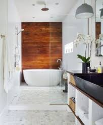 accent floor to ceiling grey subway tile wall makes the thin