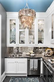 kitchen marble stove backsplash airmaxtn backyard decorations 13 best maison scott images on pinterest the servery off the dining room has a statement light fixture and antiqued mirror backsplash