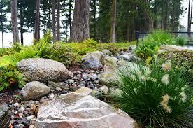 camano island modern natural rain garden with river rock and