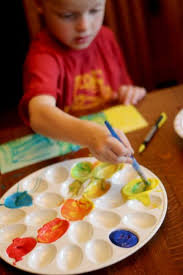 make paint swatches by mixing colors for kids hands on as we grow