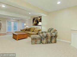 traditional family room with high ceiling u0026 carpet in reston va