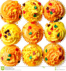 halloween background colors cupcakes with yellow and orange frosting and colored sprinkles