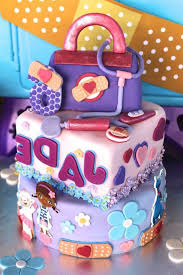 doc mcstuffins birthday party cake from a doc mcstuffins birthday party via kara s party ideas