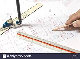 hand holding pencil point to architectural plans project drawing