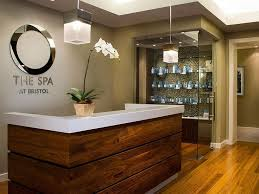 love the grey mixed with wood and sparkle in the background spa spa at bristol small reception deskspa