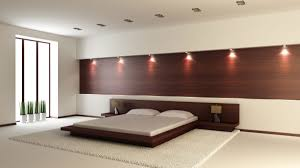minimalist bedroom with artistic over headboard recessed lighting