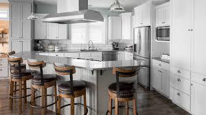 white shaker kitchen cabinets with gray quartz countertops gray and white shaker cabinets coastal cottage highcraft